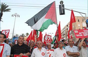 Слева направо: члены кнессета от Хадаш - Хенин, Бараке, Агбария, мэр Назарета Джарайси, член кнессета Свеид и Секретарь Хадаш Эйман Одех на марше в Тель-Авиве